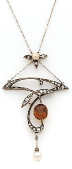An Art Nouveau gold, silver, citrine, and diamond pendant, circa 1900.