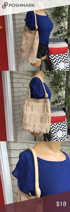 Light camel fringe tote shoulder bag Light camel tan fringe front tote bag. Magnetic snap button closure. No pockets or zippers inside. Inside is lined and in great condition. Outside has a few spots- see close up. Large size. Faux. Bags