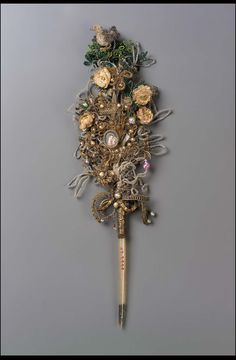 Marriage sablé pen, catholic, gold and silver filigree, sablé gold and silver wire work of flowers, leaves, loops, and crown, natural decoration of artificial flowers, beaded green leaves,beaded bird in green tree at top, and miniature of Madonna and Child. Tied together onto feather with wire. English 18th century | Museum of Fine Arts, Boston