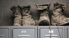 Coal mining boots are shown above miners' lockers before the start of an afternoon shift at a coal mine near Gilbert, West Virginia May 22, 2014. With coal production slowing due to stricter environmental controls, the availability of natural gas and a shift to surface mining, the state's coal country has been hit hard with job losses and business closures. Picture taken May 22, 2014.