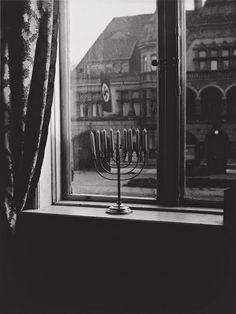 "She wrote a few lines in German on the back of the photo. ""Chanukah, 5692. 'Judea dies', thus says the banner. 'Judea will live forever', thus respond the lights."""