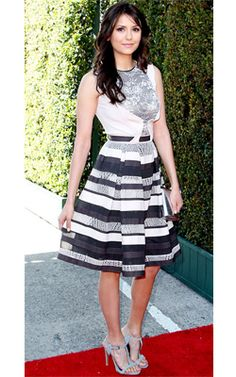 Nina Dobrev looked stunning yesterday in this @Karmien Roux Nys Saab dress, styled by Ilaria Urbinati