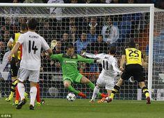 Real Madrid 3 Borussia Dortmund 0: Gareth Bale slots the ball past Dortmund goalkeeper Roman Weidenfeller for the opening goal.