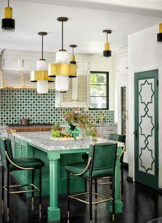 Green accents (kitchen chairs, custom cabinet­ry, and Moroccan tile) in designer Martyn Lawrence Bullard& kitchen pick up the colors of the leafy garden just beyond the glass doors. Kitchen Chairs, Kitchen Tiles, Kitchen Decor, Dining Chairs, Moroccan Tiles Kitchen, Decorating Kitchen, Diy Decorating, Home Design, Interior Design Kitchen