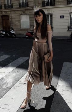 a pleated skirt with an off the shoulder look