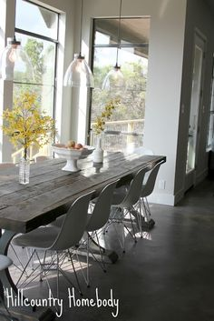 Rustic Modern Dining Room White modern Chairs/Farmhouse table Hill Country Homebody Rustic Dining Chairs, White Dining Table, Dining Room Table, Dining Rooms, Rustic Table, Table Lamp, Dining Chandelier, Dining Room Lighting, Style At Home