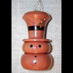 Snowman, hand turned,   wood Christmas Ornament, handmade cedar, personalized free. $5.99, via Etsy.