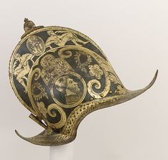 Italian, Brescia Burgonet of the Guard of Pope Julius III, ca. 1550–55  The medallions decorating each side show a profile portrait of Pope Julius III (Giovanni Maria del Monte, 1487–1555, elected pope in 1550). This helmet is a precursor to the Brescian-made armor traditionally worn by the Papal Swiss Guard beginning in the late sixteenth century, versions of which are still worn by the Papal Guard today.