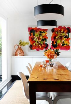 Bold Accent Paintings: We're beginning to see a pattern here: Incredible light fixtures, florals and metallic accents and beautiful wooden tables!
