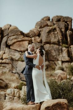 A bride and groom in their modern wedding attire in Pioneertown, California. Bride wearing modern wedding dress and long cathedral veil. Boho Bride, Boho Wedding Dress, Wedding Attire, Wedding Dresses, Modern Minimalist Wedding, Modern Boho, Joshua Tree Wedding, Big Sur Wedding, Alternative Bride