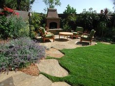 nice corner patio with fireplace. Nice use of stepping stone to border planting area