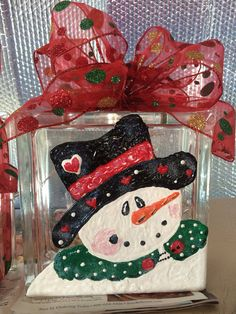 Love this Snowman! Big happy snowman and her magical black hat. Glass Block, comes with corded lights and giant Bows. Can custom design to Christmas Snowman, Christmas Stockings, Christmas Ideas, Christmas Crafts, Xmas, Painted Glass Blocks, Decorative Glass Blocks, Giant Bow, Hand Painted Wine Glasses