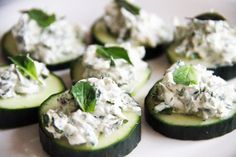 A healthy appetizer for your carb-heavy holiday season: herbed cream or goat cheese and cucumber bites. This looks amazing!