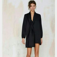 ✨HPx2✨ NASTY GAL Winona satin dress NWOT This dress is killer! Black satin. Features plunging neckline, poet sleeves, loose fit, oversized wrap neck collar with gathering detail. Tts. New with out tags. Lined. Self  and lining 100% polyester. Nasty Gal Dresses Mini