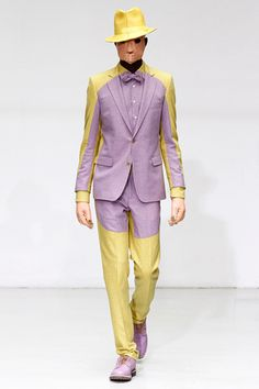 Walter Van Beirendonck  Looks like a massive stain! Only the right guy could see the humor in this and wear it. Perhaps at Easter .... with an egg under the hat.