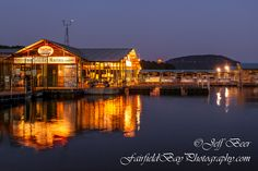 The moon rises over Sugarloaf Mountain in Greer's Ferry Lake, with the Fairfield Bay Marina in the foreground.