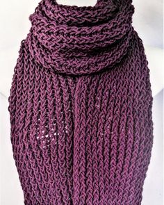 Check out this item in my Etsy shop https://www.etsy.com/uk/listing/543633041/purple-knitted-scarf-aran-wool-scarf