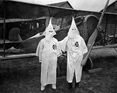 """Invisible empire"" takes to the air, 1924  ""There has existed since 1868, in many counties of the state, an organization known as the Ku Klux Klan, or Invisible Empire of the South, which embraces in its membership a large proportion of the white population of every profession and class. The Klan has a constitution and bylaws, which provides, among other things, that each member shall furnish himself with a pistol, a Ku Klux gown and a signal instrument. The operations of the Klan are…"