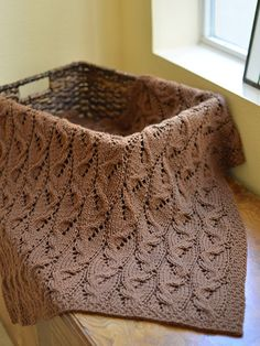 """Uniquely cabled blanket with gorgeous results.   The interesting stitch pattern in this blanket makes it truly unique and a standout throw. Knit with approx 600 (1,030, 1,435, 2,700) yds of worsted-weight yarn at a gauge of 17 sts and 25 rows per 4"""" using U.S. size 9/5.5mm 24 (24, 32, 47)"""" circular needle. Finished size is 26 (31 1/2, 39 1/2, 51 1/4)"""" x 28 3/4 (41 1/2, 46, 65 1/4)""""."""