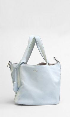 Baby Blue Also comes in beige and peach Comes with a smaller size bag/ pouch inside Textured leather outer SHALS embossed logo Outer bag : Twin grab handles O Embossed Logo, Baby Blue, Pouch, Beige, Tote Bag, Leather, Collection, Sachets, Porch