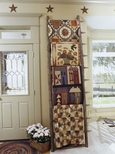 quilts displayed on a primitive ladder