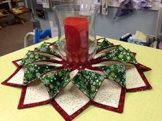 Fold and Stitch Wreath. Made from squares. Really clever and results are impressive! Designed by Christine Poor.