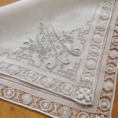 A fabulous vintage Swiss monogrammed handkerchief with the letter A. Whitework embroidery with drawn work border.