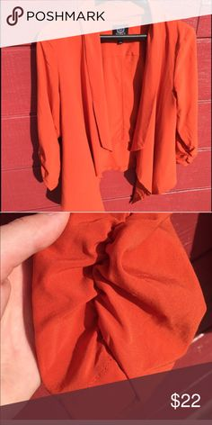 Lovely Orange Blazer Fits a Medium best. It's a pretty orange color and lightweight. Excellent condition Jackets & Coats Blazers