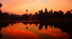 A fiery red and orange sunrise over Angkor Wat, Cambodia  This page lists advice about hiring tuk-tuk driver (not a guide)
