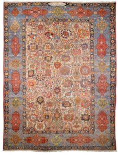BACHTIAR PALACE CARPET antique.Beige central field patterned throughout with colourful, large trailing flowers and palmettes, light blue border with floral cartouches, good condition, small worn part to be restored, 450x665 cm.