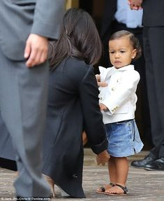 edea5b8334 Her little princess  North stole the show in a denim skirt paired with  black sandals