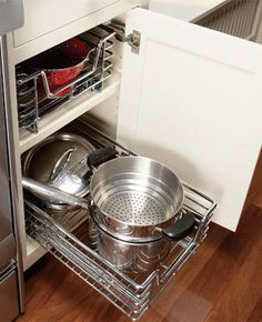 Rollouts turn wasted space deep inside cabinets into accessible storage space.    Photo by Ramon Moreno