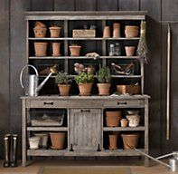 RH's Potting Bench Deluxe:Inspired by a classic English potting bench, ours is crafted from sturdy zhu wood, a hardwood similar to oak, bearing a wire-brush weathered grey finish that looks already at home in the elements.