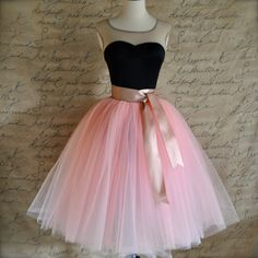 Vintage pink tulle skirt with satin ribbon sashed adult tutu. Romantic tea length.