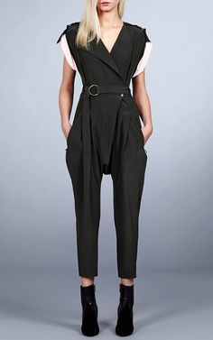This belted **Roberto Cavalli** jumpsuit is rendered in silk and features contrasting pull up sleeves, a crossover rounded neckline, a loose fit at the hips and a skinny fit cropped leg.