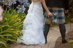 fun wedding photo with groom in kilt
