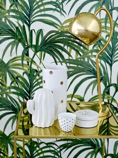 gold bar cart, gold table lamp, white and gold ceramics and leaf print wallpaper… Interior Tropical, Tropical Home Decor, Tropical Design, Tropical Style, Tropical Houses, Tropical Prints, Decoration Cactus, Estilo Tropical, Tropical Bedrooms