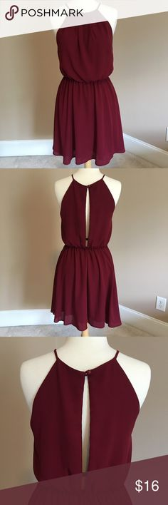Burgundy Dress with Slit in Back Fun and Flowy burgundy dress! Gathered at waist with button and slit in the back. Perfect for game day! Worn only once! Dresses Mini