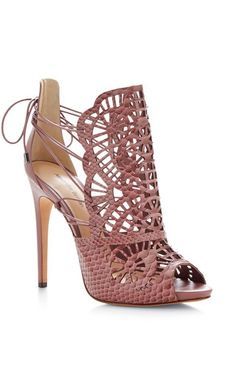 Towering in a fine blushing pink lace latticework Alexandre Birman's heels epitomize luxury, both utterly lavish and undeniably glamorous. salmon leather and snakeskin sandal with laser cut designMade in Brazil