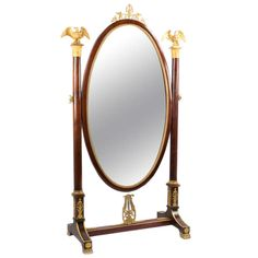 A Napoleon III Full-length Ormolu And Mahogany Mirror | From a unique collection of antique and modern floor mirrors and full-length mirrors at http://www.1stdibs.com/furniture/mirrors/floor-mirrors-full-length-mirrors/
