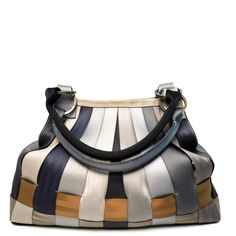 The Large Stella Hobo features a woven base with vertically stitched trunk in a tear-drop shape. It includes magnetic top closure to secure your belongings and two piped seatbelt handles with antique brass o-ring accents that fit comfortably over the shoulder. #Harveys #seatbelt #upcycle #reuse #repurpose