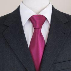 fuschia tie with black suit