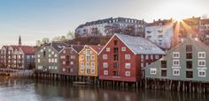 The signature wooden wharfs of Trondheim is beautifully located in the banks of the river Nidelven - Photo: Sven-Erik Knoff/www.fotoknoff.no...