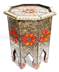 can you say...wow.  silver table.  Amazing workmanship and how ethnic! - can make with wood and paint...