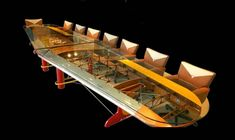 Airplane Wing Conference Table by Motoart. Obviously not very practical for household use but so very cool.