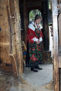 This looks like Gol stavechurch at Olso folkemuseum, one of the guides standing in the doorway.