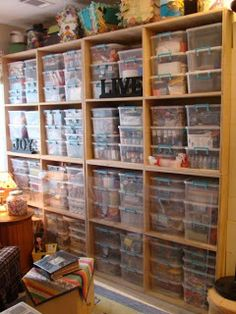 This is my Supply wall. When I decided to re-model my Scrapbooking room, I realized that with baskets, and Boxes I never knew what I had and that if I did know I had it, I could not always find it. The clear containers by Sterlite gave me modular storage that allows me to see exactly what is in the bins. I have created a spread sheet with what is in my Bins so it is easy as pie to find what I am looking for.