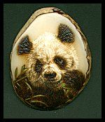 'Eating Bamboo' - Panda. Burnt on a tagua with a touch of added acrylic colour. Sold