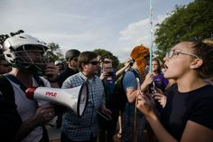 Federal judge stops Auburn from canceling white nationalist Richard Spencer speech. Protests and a scuffle greet him.    At least three were arrested Tuesday evening.