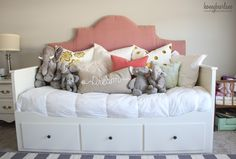 Daybeds are ideal for a bedroom that needs to serve as both a sleeping area and a hang out area, which is why this blogger opted for this IKEA HEMNES piece for her daughters space and added a feminine headboard that makes it feel one-of-a-kind. See more at Honey Bear Lane »